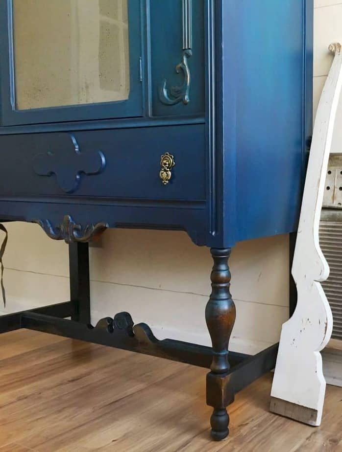 Learn How to Paint Furniture in the rustic glam finish like this cabinet side