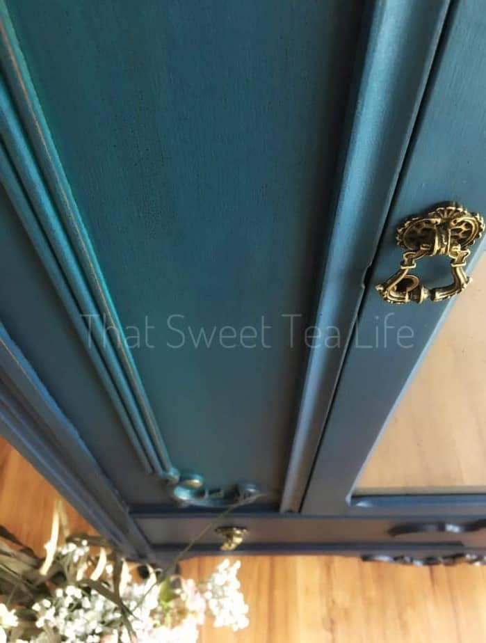 Learn How to Paint Furniture in the rustic glam finish like this door