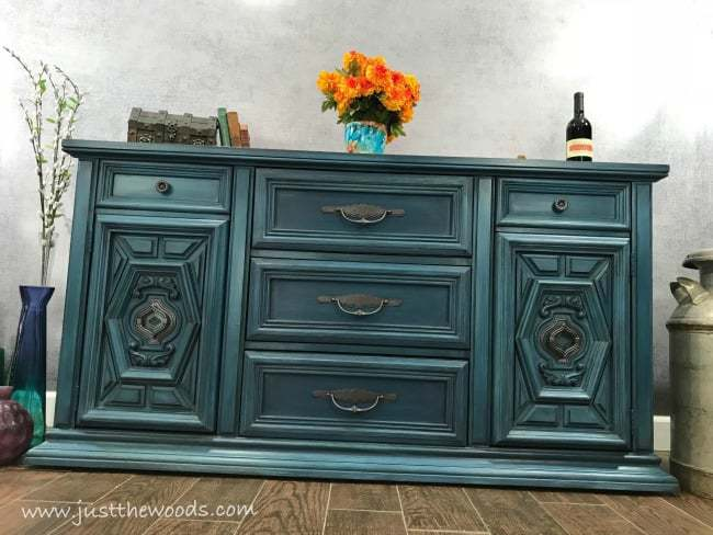 Layered-teal-paint-on-buffet