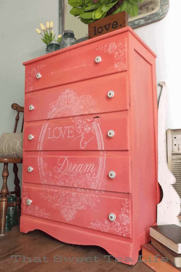 Coral Painted Dresser Makeover with image transfer.  White flowers on a coral dresser.
