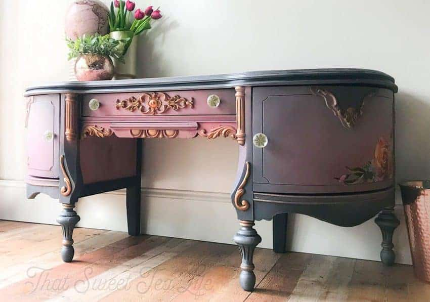 Painted wood vanity with appliqués