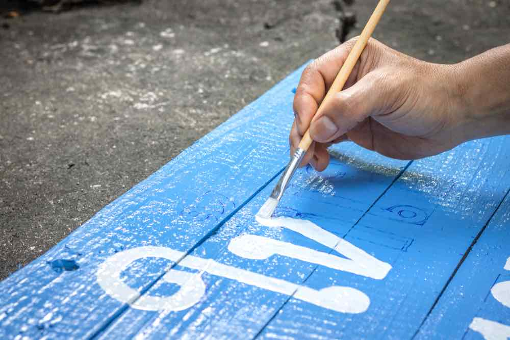 Painting a sign with acrylic paint