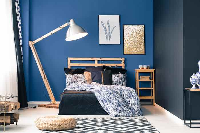 Bedroom with walls painted Royal Blue.