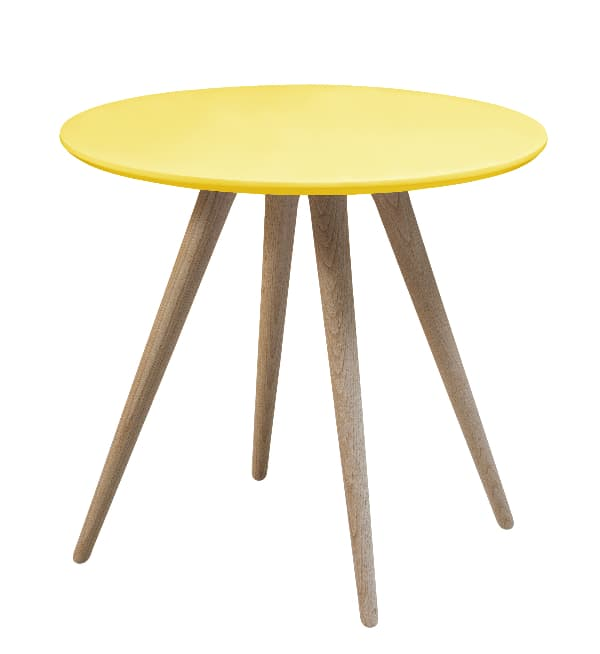 A modern style painted table with a round yellow top and four angled legs of natural wood.