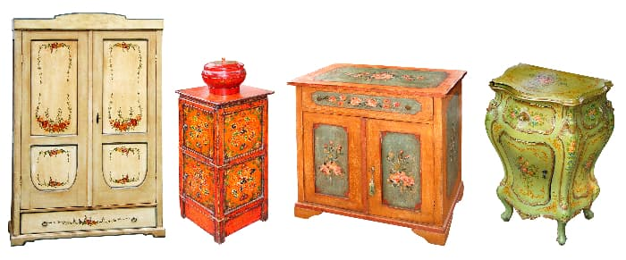 Four elaborately painted dressers in antique white, red, varnished wood, and pale green.