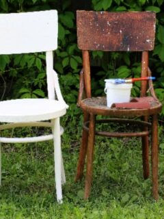 Two chairs representing before/after of a paint over stain project.