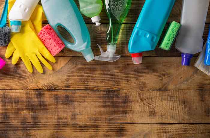 Variety of cleaning products and supplies to clean furniture before painting.