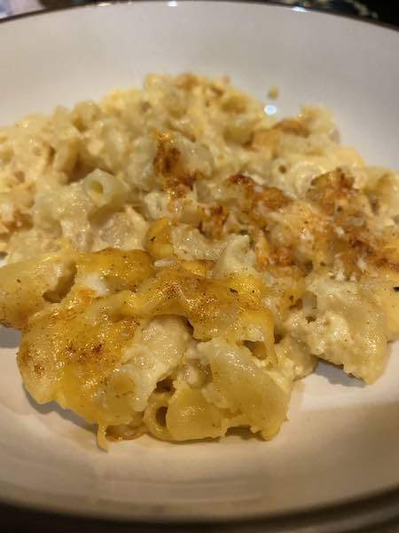 Bowl of creamy baked mac and cheese, ready to enjoy!