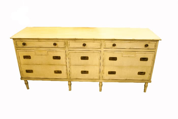 A white painted dresser/sideboard with the antique patina created by applying stain over paint.