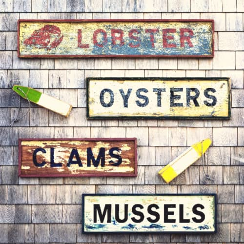 Coastal theme farmhouse signs advertising  lobster, oysters, clams, and mussels