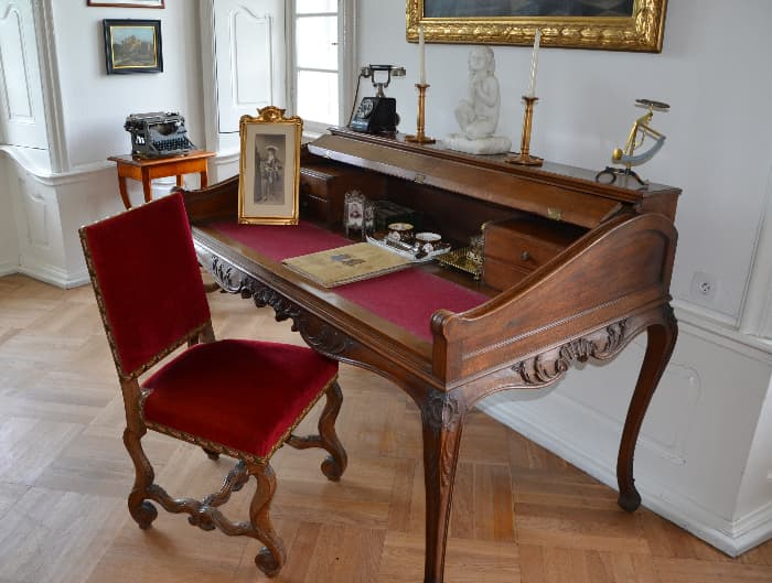 High-End Roll Top farmhouse desk with red velvet chair.