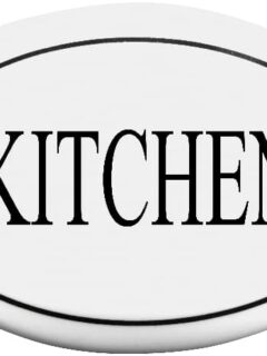 A white farmhouse kitchen sign plaque reading