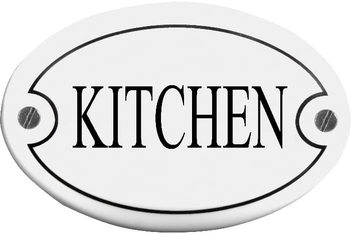 """An oval white farmhouse kitchen sign reading """"KITCHEN"""" is crisp black letters."""
