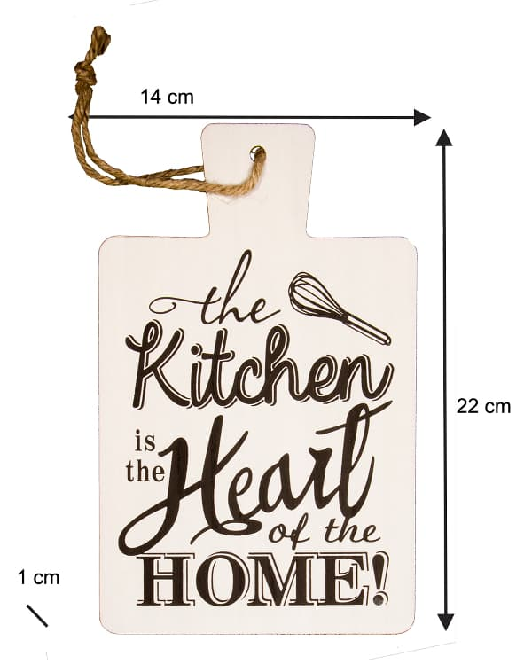 """A white paddle used as farmhouse kitchen sign with the inscription """"the Kitchen is the Heart of the HOME!"""" in dark lettering."""