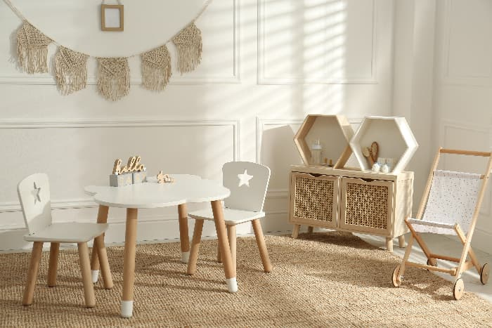 White children's table and chair set in white room.
