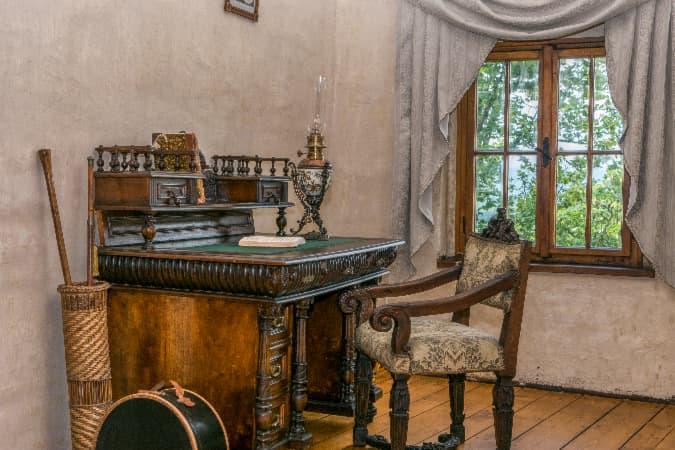 Ornate, medieval-style farmhouse desk.