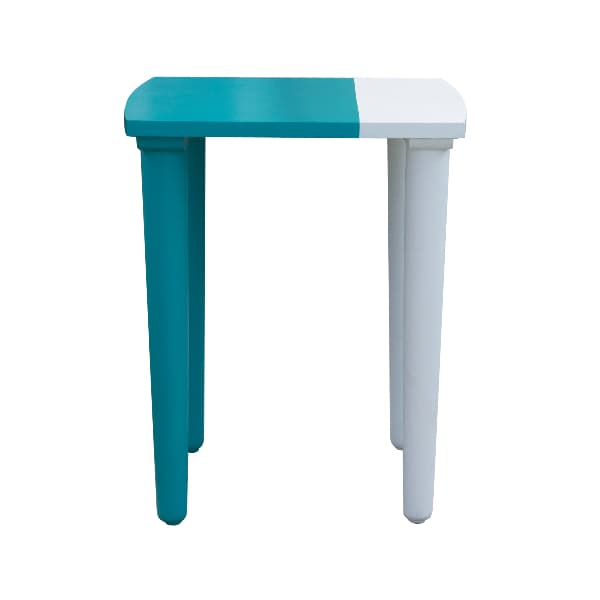 An Uber Modern painted table against a white background. An end table asymmetrically painted in two different colors -- dark teal on the left side and light blue on the right.