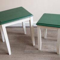 Painted tables in a green and white color scheme.