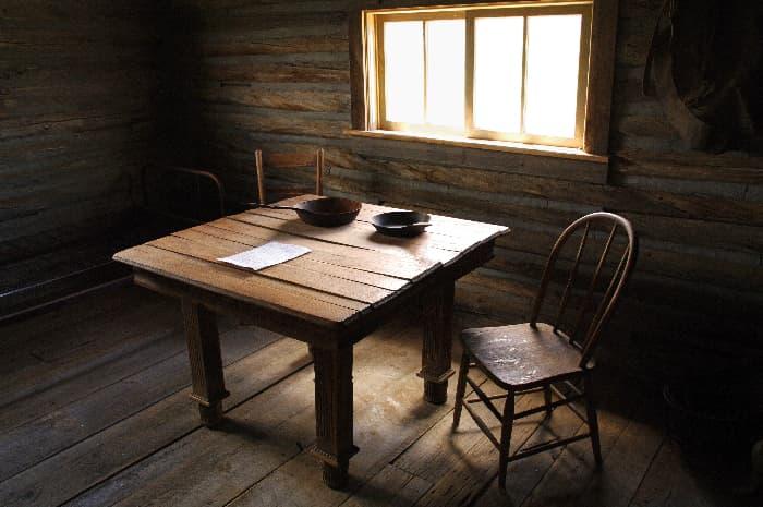 Table made of dark wood planks.