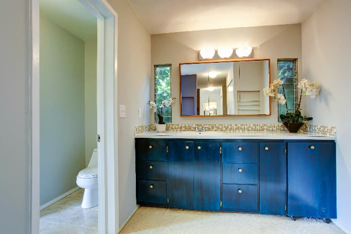 Bathroom with cabinets painted Royal Blue.