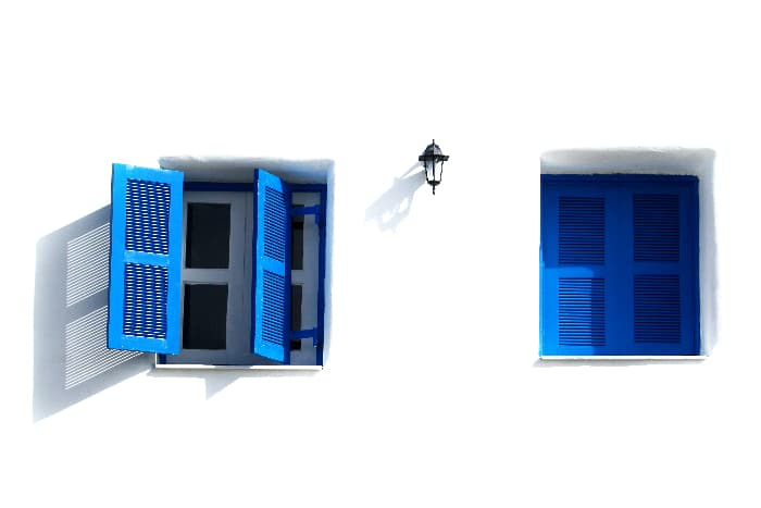 Greek-style shutters painted Royal Blue.