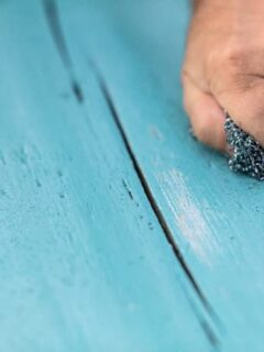 Sanding to remove chalk paint.