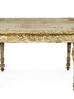 Ornate white painted table with patina effect that stain over paint creates.