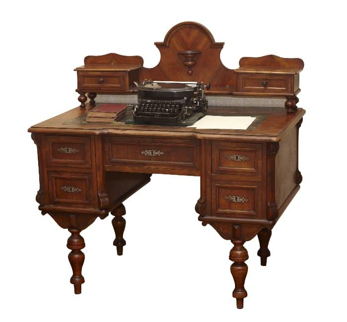 "Dark wood ""Tiptoe"" farmhouse desk."