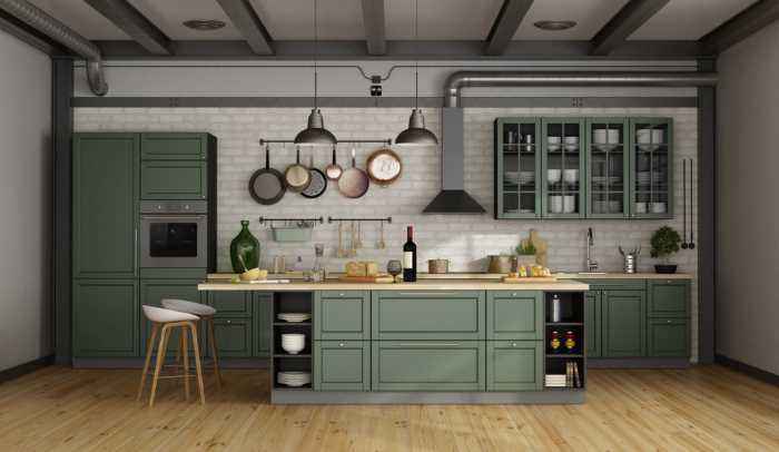 A modern kitchen with white tiles, white walls and ceiling, green painted cabinets, and a green kitchen island .