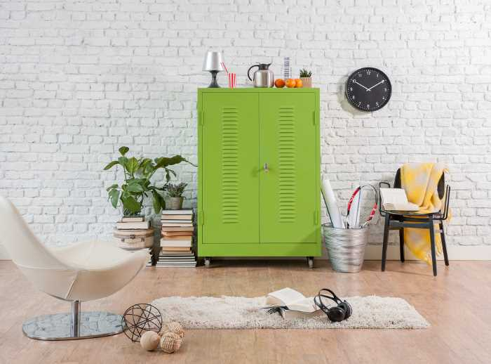 A yellow green utility cabinet as coffee bar