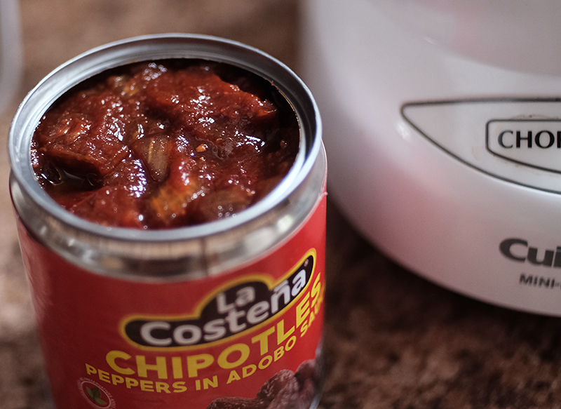 Overhead view of opened can of chipotles.