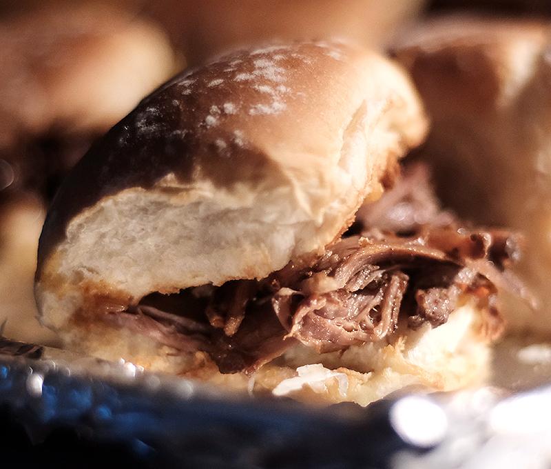 Slider buns filled with shredded beef.