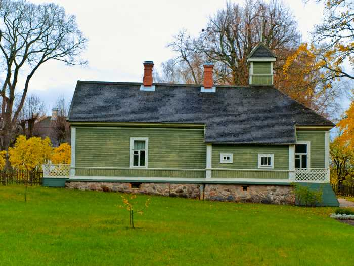 rural green painted house in autumn